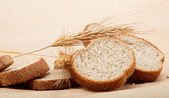 Fresh bread isolated on a light brown background. — Стоковое фото