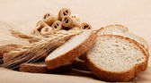 Fresh bread on a light brown background. — Foto Stock