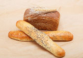Fresh bread on a light brown background. — Stockfoto