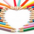 Colored pencils crayons composed in form of heart — Foto Stock #9593534