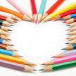 Colored pencils crayons composed in form of heart — Stockfoto #9593534