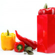 Healthy food. Fresh vegetables.Peppers in red gift bag on wh — Stock Photo #9593820
