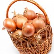 Fresh bulbs of onion in basket on a white background - Stock Photo