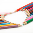 Stock Photo: Colored pencils crayons composed in form of heart