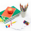 School supplies: books, notebook, pens, pencils, an apple on a w — Stock Photo