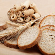 Stock Photo: Fresh bread on light brown background.