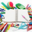 School supplies: notebook, pens, pencils on a white background. — Photo