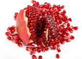 Pomegranate seeds on a white background — Stock Photo