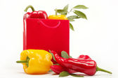 Healthy food. Fresh vegetables.Peppers in a red gift bag on a wh — Stock Photo