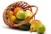 Fruits in basket isolated on a white background. — Stok fotoğraf