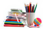 School supplies: notebook, pens, pencils on a white background. — Foto de Stock