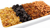Mixed nuts and dried fruits. Almonds, raisins and prunes. — Stock Photo