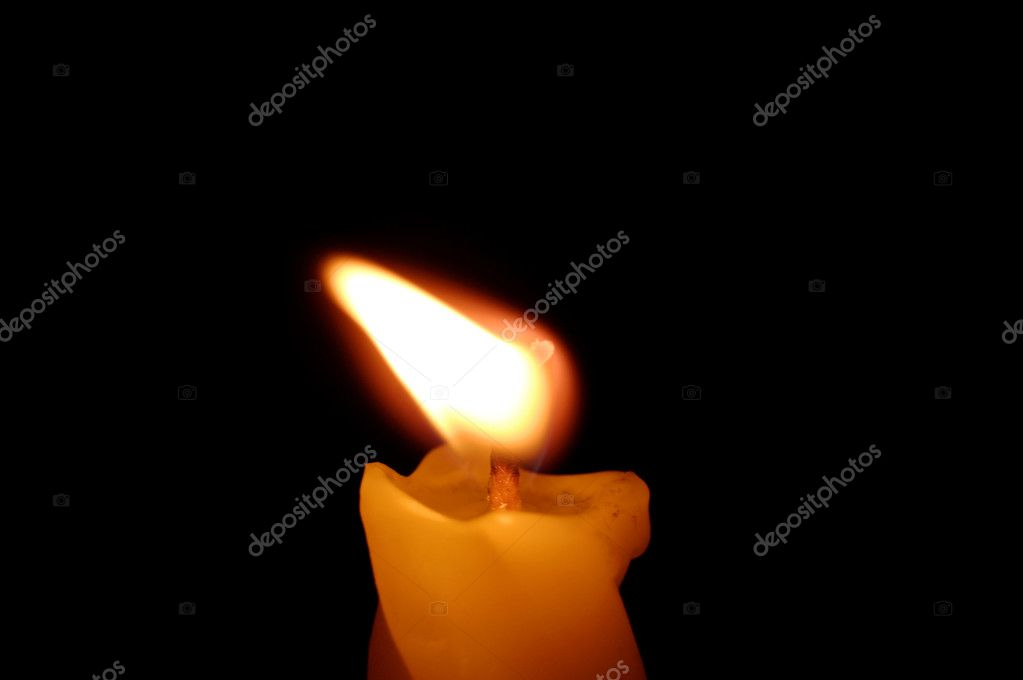 Yellow candle on black background — Stock Photo #9833802