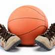 Royalty-Free Stock Photo: The new sports shoes with the ball on a white background.
