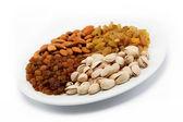 Nut-raisin mix. Almond and pistachio nuts and raisins. — Stock Photo