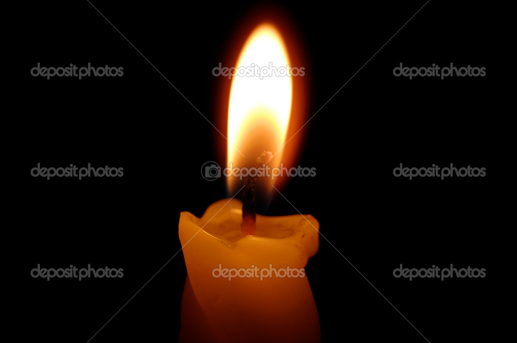Old yellow candle on black background.  Foto Stock #9878307