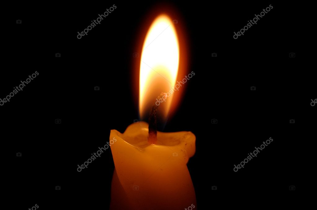 Old yellow candle on black background. — 图库照片 #9878307