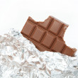 Chocolate bar in foil isolated on white background — ストック写真
