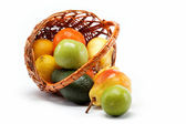 Fruits in basket isolated on a white background. — Stock Photo