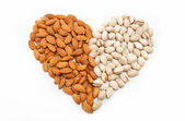 The image of the heart of the almond and pistachio nuts. — Stock Photo
