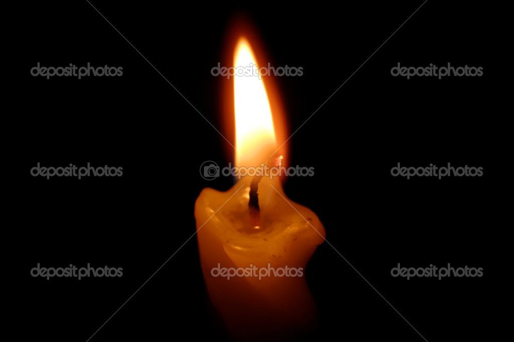 Old yellow candle on black background. — Stockfoto #9920659