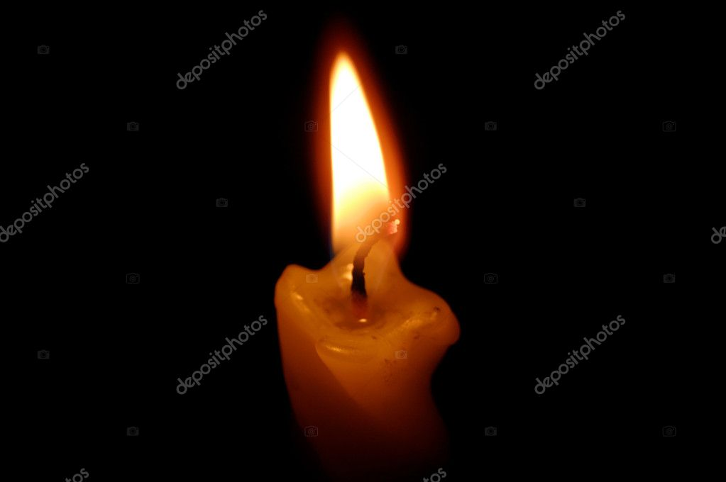 Old yellow candle on black background.  Zdjcie stockowe #9920659