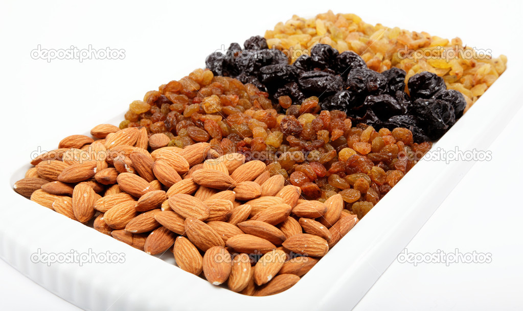 Mixed nuts and dried fruits. Almonds, raisins and prunes. — Stock Photo #9920764