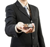 Businessman holding mobile phone — Photo
