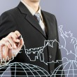 Businessman hand drawing the dream travel around the world — Stock Photo