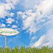 Recycle on wood sign and grass — Lizenzfreies Foto
