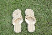Handmade slipper on grass — Stock Photo