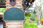 Wooden blank sign and welcome — Stock Photo