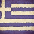 Old grunge paper with  Greece flag background — Stockfoto