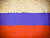 Old grunge paper with Russia flag background — Stock Photo