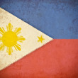 Old grunge paper with Philippines flag background — Zdjęcie stockowe