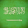 Foto Stock: Old grunge paper with Saudi Arabiflag background