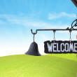Welcome Sign on wall - Stock Photo