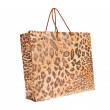 Paper shopping bags with leopard or jaguar pattern — Stock Photo