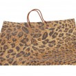 Paper shopping bags with leopard or jaguar pattern - Stock Photo