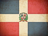Old grunge paper with Dominican Republic flag background — Stock Photo