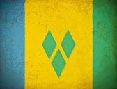 Old grunge paper with Saint Vincent and Grenadines flag backgrou — Stock Photo