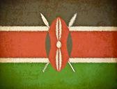 Old grunge paper with Kenya flag background — Stock Photo