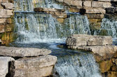 Closeup of beautiful waterfall in the park — Stock Photo