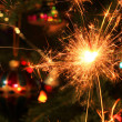 Stock Photo: Christmas tree decorations and burning sparkler