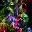 Extinguished candles with colorful smoke on black — Stockfoto