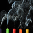 Five color extinguished candles on black background — Stock Photo #9658605