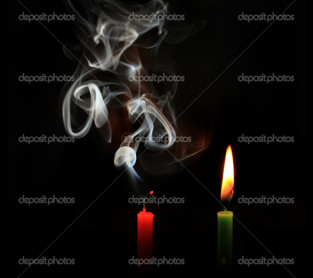 Burning and extinguished candles on black background  — Stock Photo #9658592