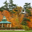 Stock Photo: Inviting gazebo in park with nice view to forest