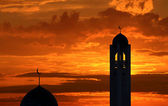 Silhouette of a mosque in sunset — Stock Photo