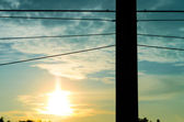 Silhouette electricity post in sky — Stock Photo